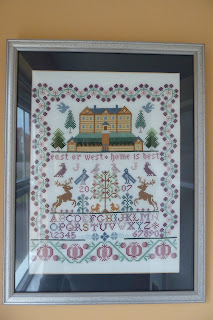Cross stitch sampler with house