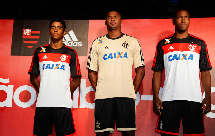 457a2ac6df2 The Flamengo 2013 Away Kit by adidas is white with black sleeves which are  continued to the upper and collar area of the shirt. There is a red stripe  below ...