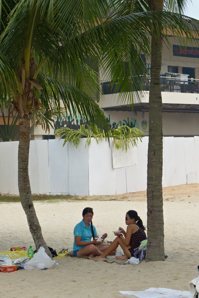 Singaporeans picnicking on the Sentosa beach