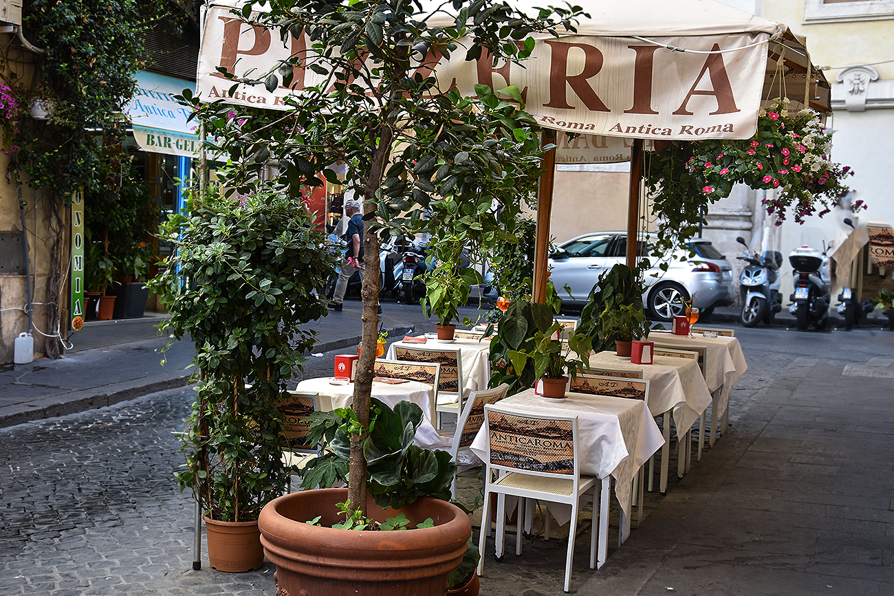 Charming pizzeria in the street of Rome, Italy