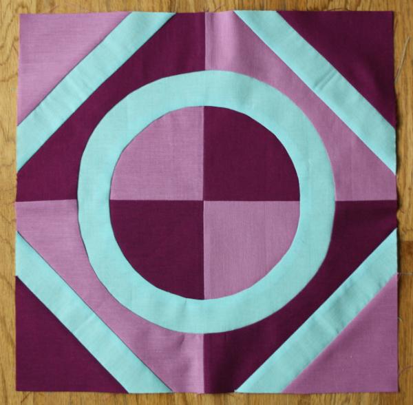 Porthole quilt block | DevotedQuilter.blogspot.com