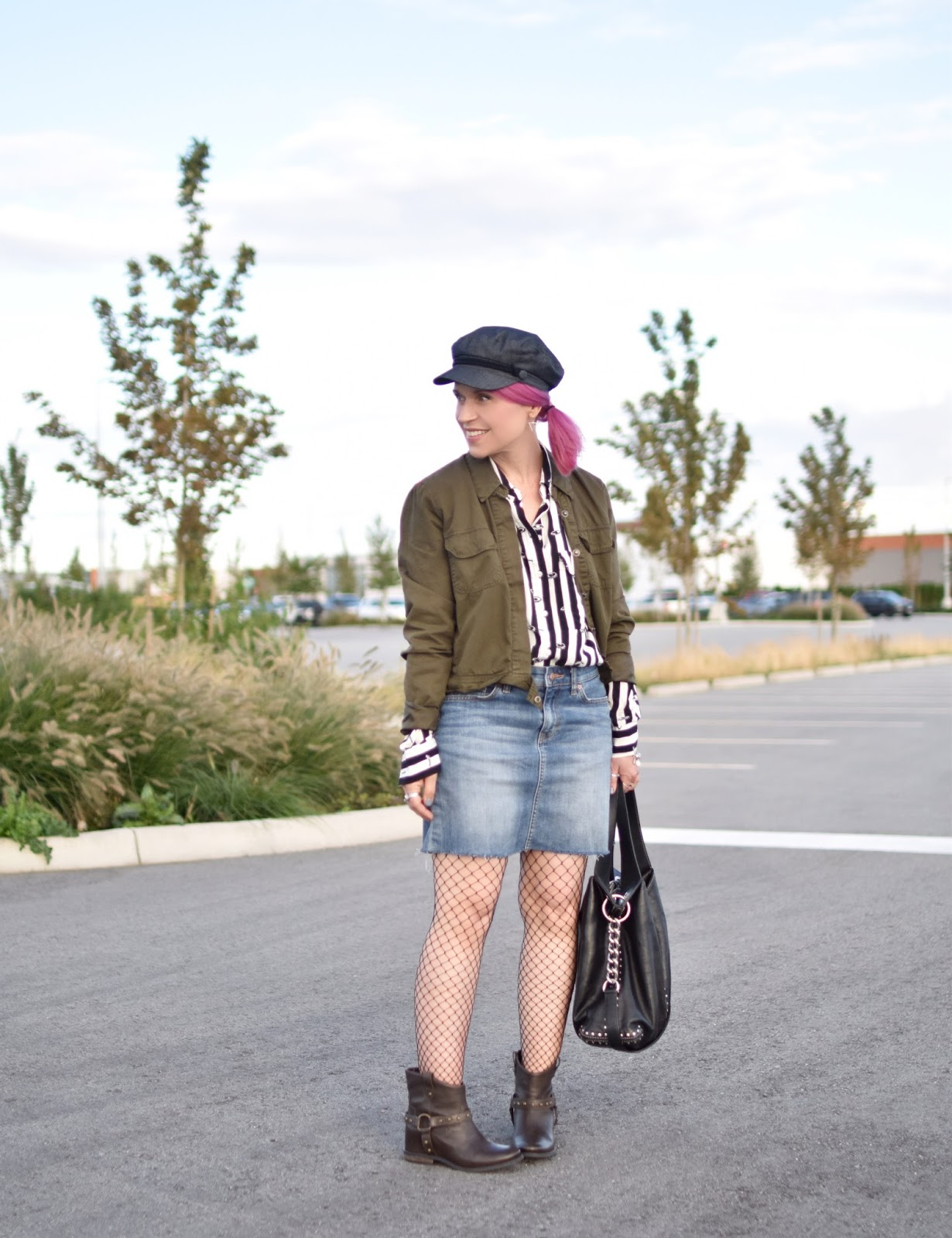 Monika Faulkner outfit inspiration - styling faux-flat harness boots with a denim mini skirt, fishnet tights, patterned shirt, and cargo jacket