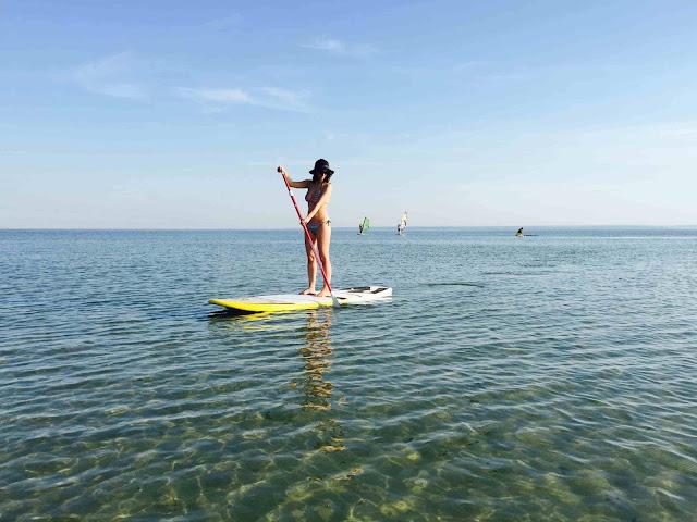 bikini girl on standup paddle board