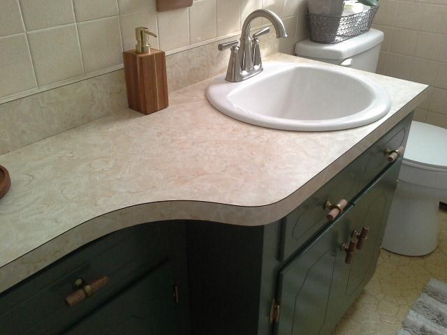 Vintage Bathroom Makeover green cabinets goose neck american standard faucet