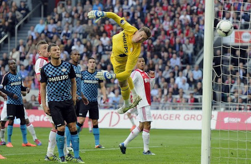 PSV goalkeeper Przemysław Tytoń fails to save a goal by Ajax player Ismaïl Aissati