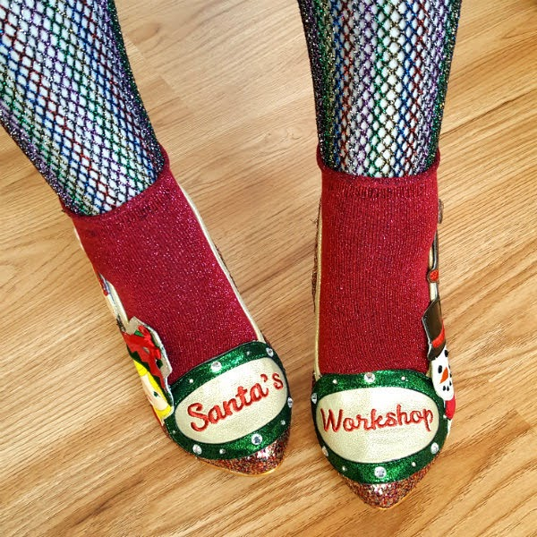 festive shoes with santas workshop signs across toes
