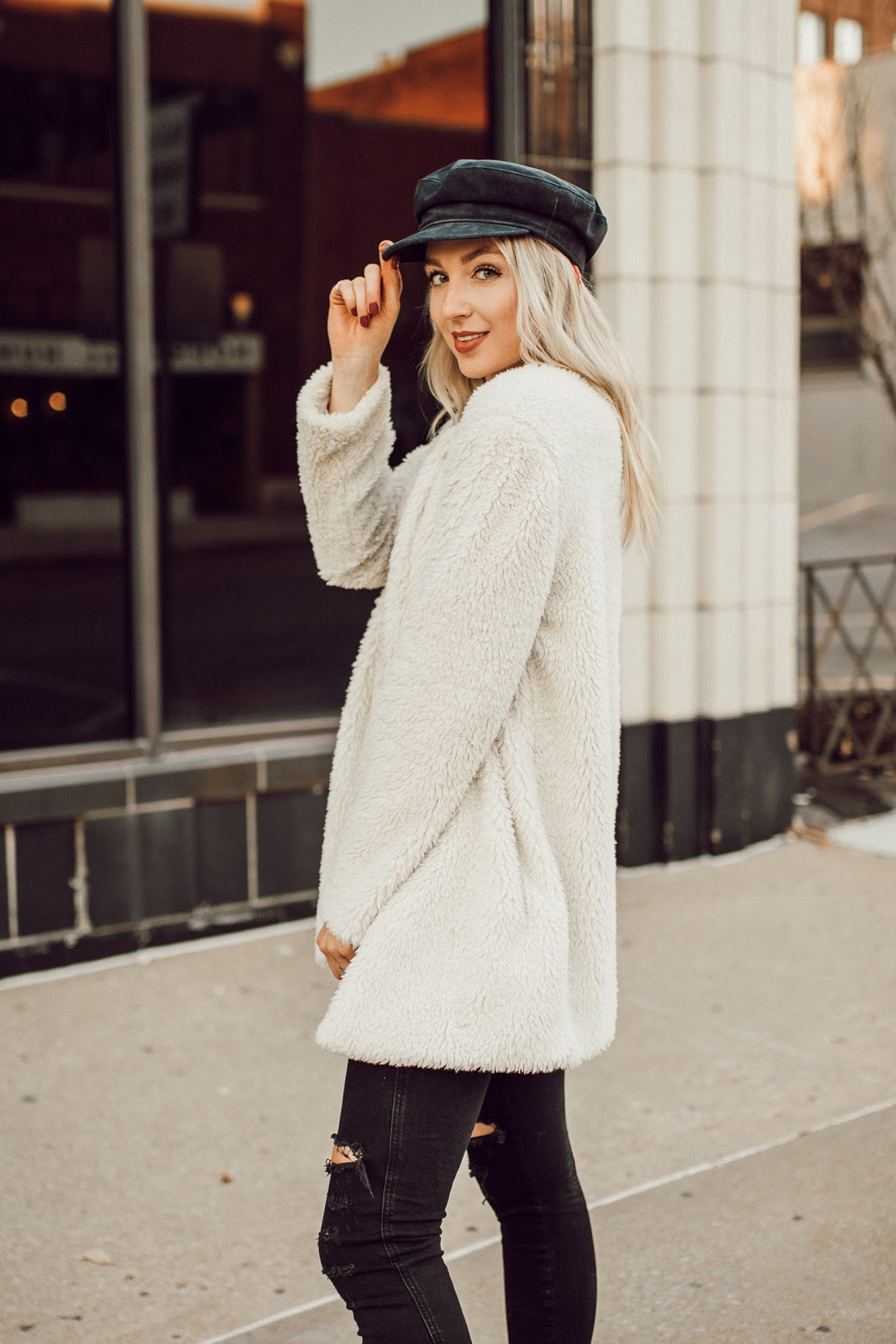 faux fur coat with a captain's hat