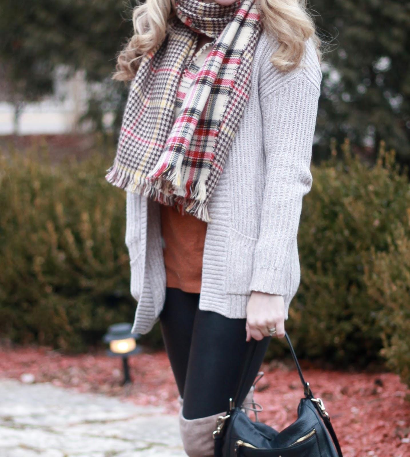 reversible plaid scarf, Spanx leather leggings, orange top, oatmeal knit cardigan, Kate Spade crossbody bag,