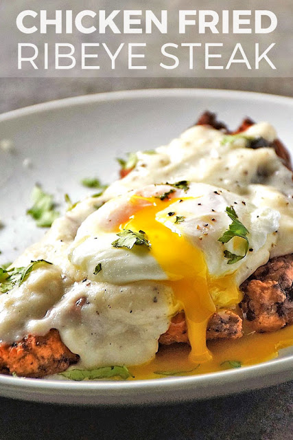 Chicken Fried Ribeye is made with thinly sliced ribeye battered and fried to a golden, crispy outside and smothered with a creamy white country gravy that is the perfect contrast to the crunchy steak. I took this recipe a step further and topped it with a perfectly poached egg for a rich, ooey gooey, irresistible twist on steak and eggs. You don't have to be from the south to love this comfort food classic!