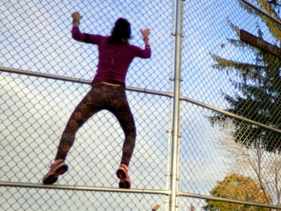 I'm climbing a fence in my purple fractal Salar leggings.