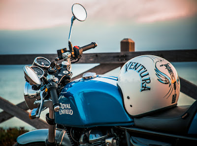 Photo of motorcycle with helmet labelled Venura on it.