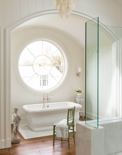 Elegant freestanding tub in Giannetti designed bathroom