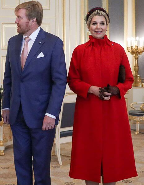 Queen Maxima and First Lady Agata Kornhauser-Duda attended the lunch at Royal Palace. She wore a red wool coat by Natan