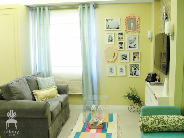 yellow green walls, small chic living room, gallery walls