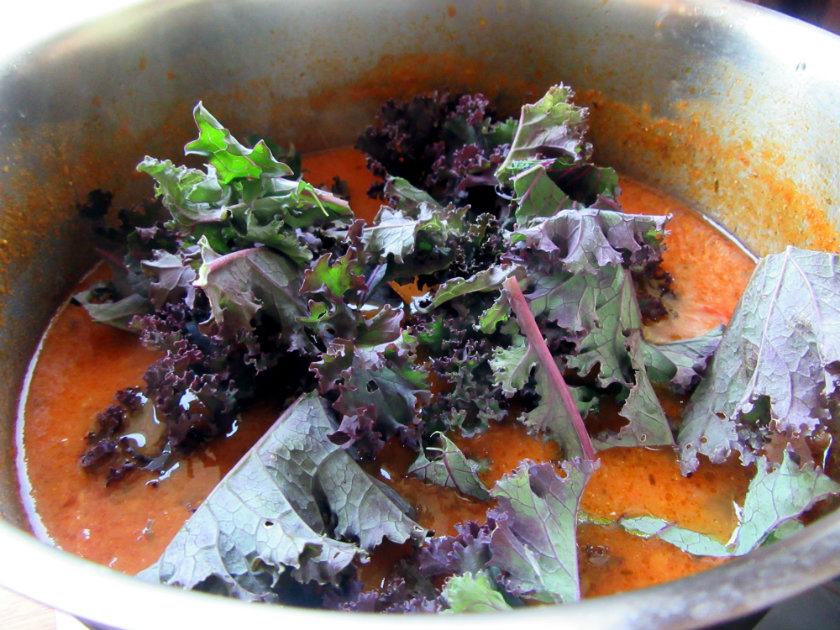 Spicy lentil soup by Laka kuharica: Stir in collard greens and cook