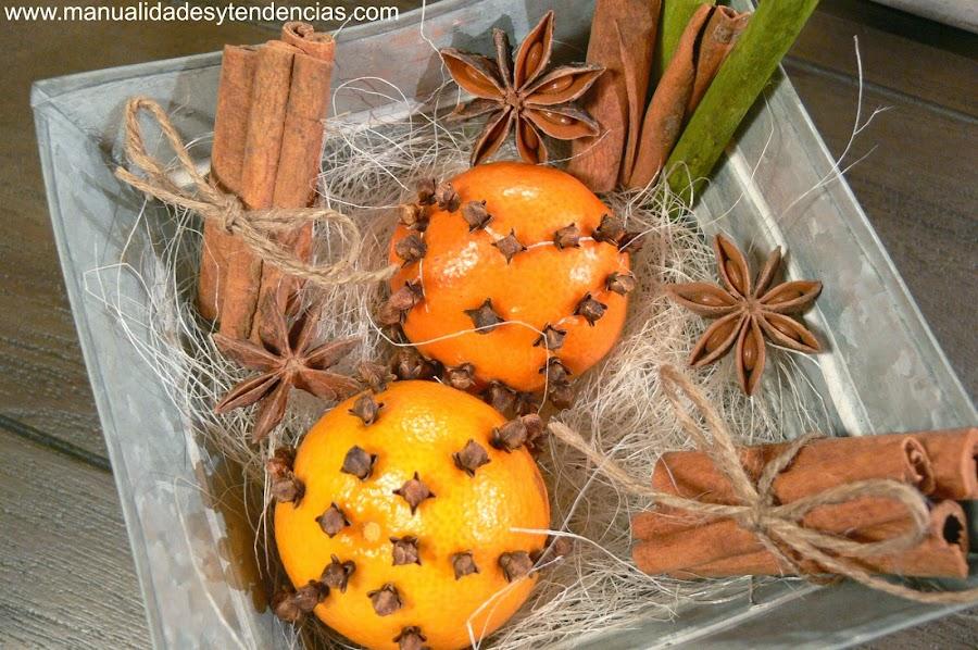 Centro de mesa con mandarinas y especias