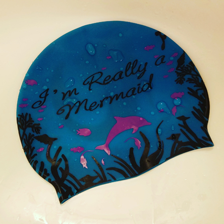 image of my swimcap that reads: 'I'm really a mermaid.'