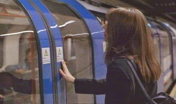 A woman on underground rail platform has just missed a train