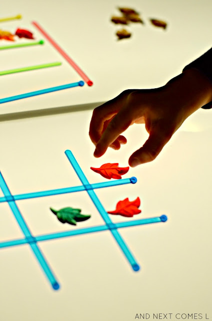 Play tic tac toe on the light table with this simple fall version of the game from And Next Comes L