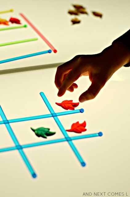 Playing fall tic tac toe on the light table with kids