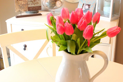 pink tulips in white pitcher