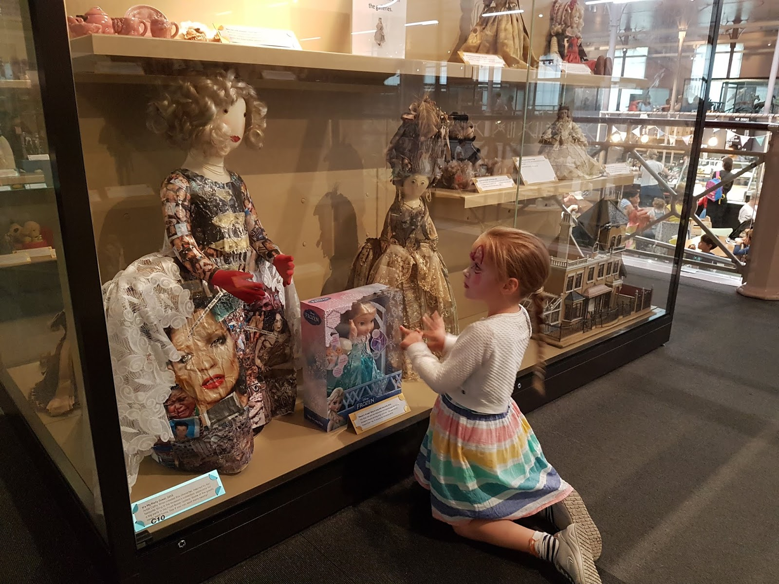 child looking at dolls