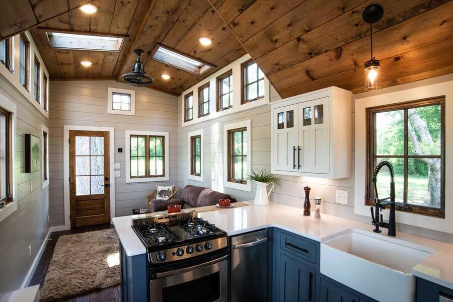 01-Kitchen-and-Entrance-Timbercraft-Architecture-in-Mobile-Tiny-House-www-designstack-co