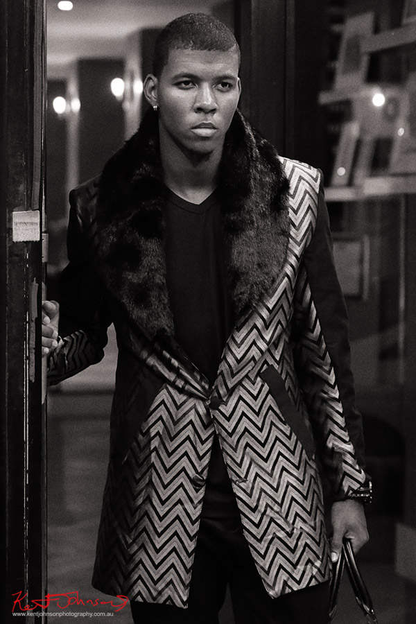 Leaving the hotel, Mens fashion night photoshoot, chevron coat, photo in black and white. Photography by Kent Johnson.