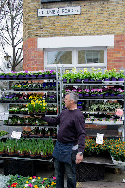 A market stall owner with daffodils