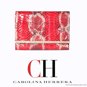 Queen Letizia and carried a red Carolina Herrera animal print clutch bag