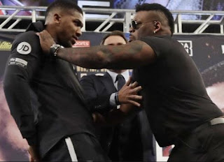 Jarrel Miller Violently Pushes Anthony Joshua At Their First Face-Off (Video)