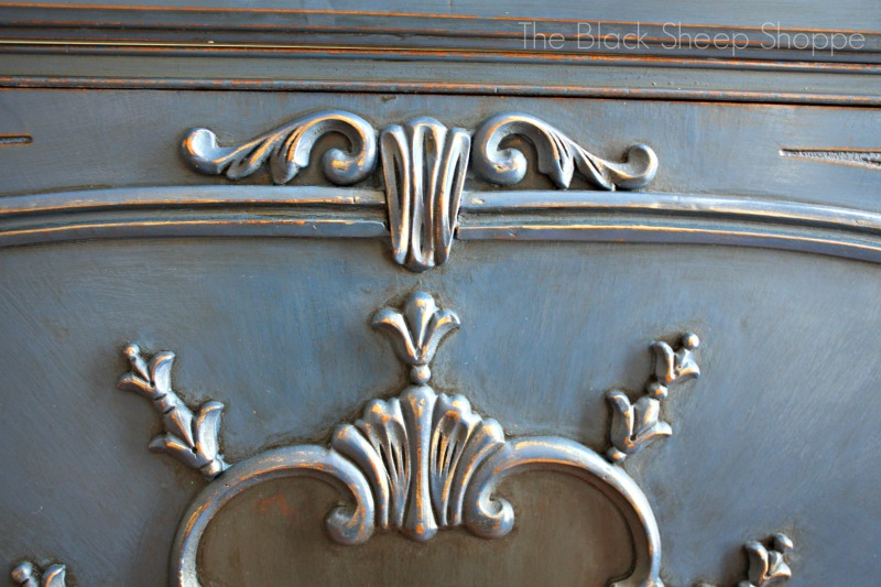 Close up of decorative trim pieces on the drawer. Painted in Napoleonic Blue.
