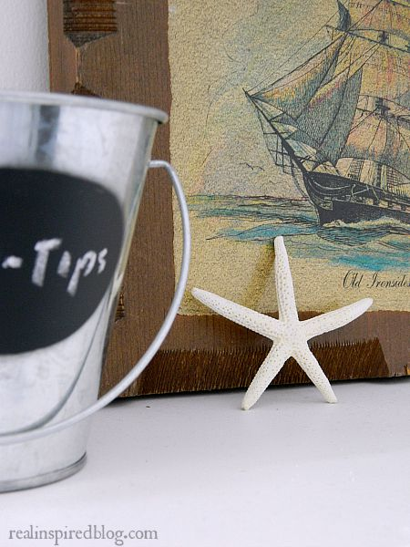 How to Decorate a Long Mantel: starfish, ship art