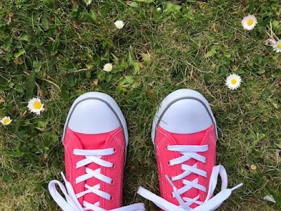 Pink trainers on the grass