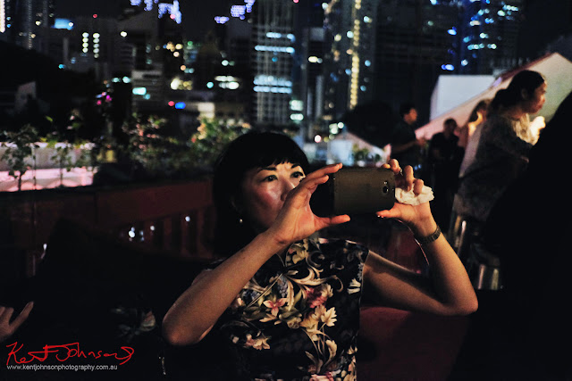 Framing a shot on the roof top bar in Singapore.  Photo by Kent Johnson for Street Fashion Sydney.