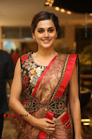 Tapsee Pannu Latest Stills in Red Silk Saree at Anando hma Pre Release Event .COM 0034.JPG