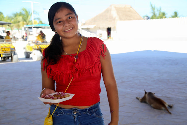 School girl selling street food, holbox mexico