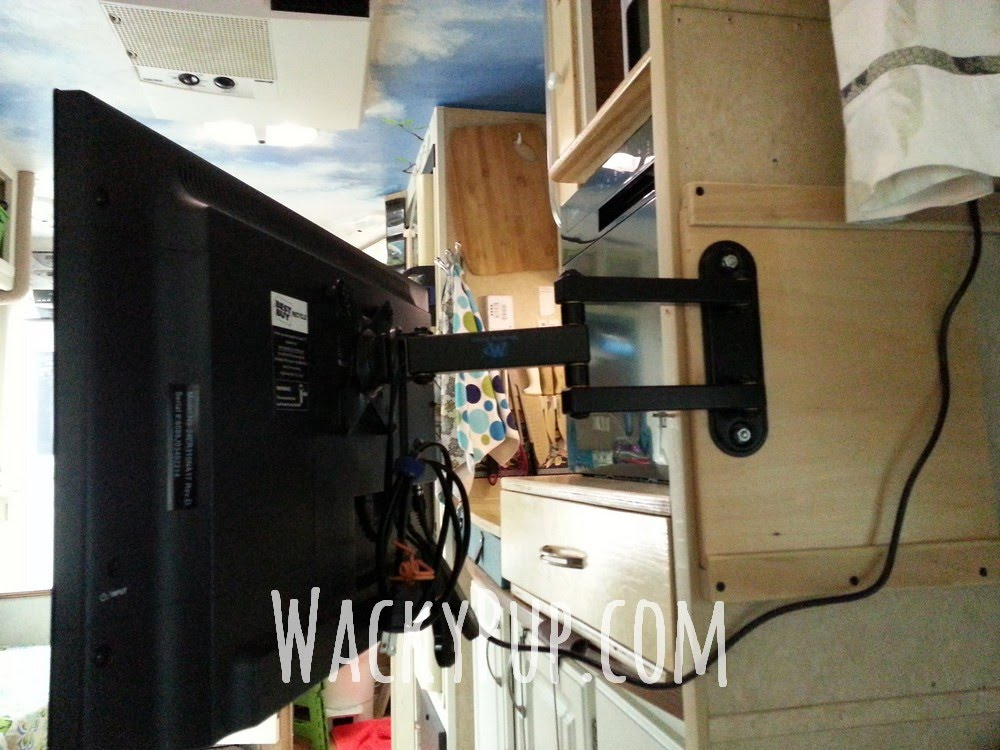 Wacky pup watch tv around corners with a diy sliding tv - Vertical sliding tv wall mount ...