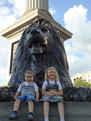 Top Ender and Big Boy in front of a Trafalger Square Lion