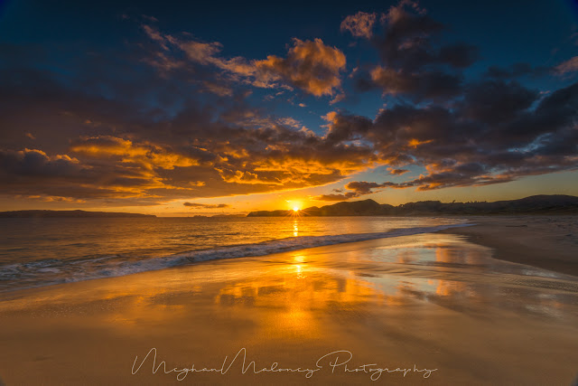 otama beach vibrant sunrise coromandel