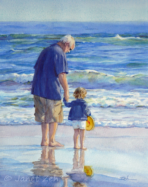 A small child visits the beach for the first time with her Grandpa