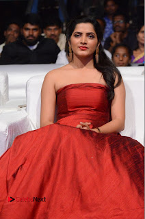 Actress Pavani Pictures in Red Long Dress at Jo Achyutananda Movie Audio Launch  0054