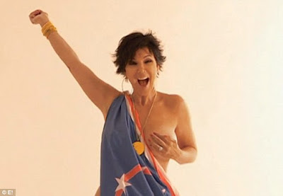 Kris appears topless with a US FLAG AND medal during a 2007 shoot