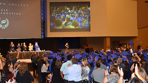 wide shot of HSE graduation finale as attendees applaud for grads