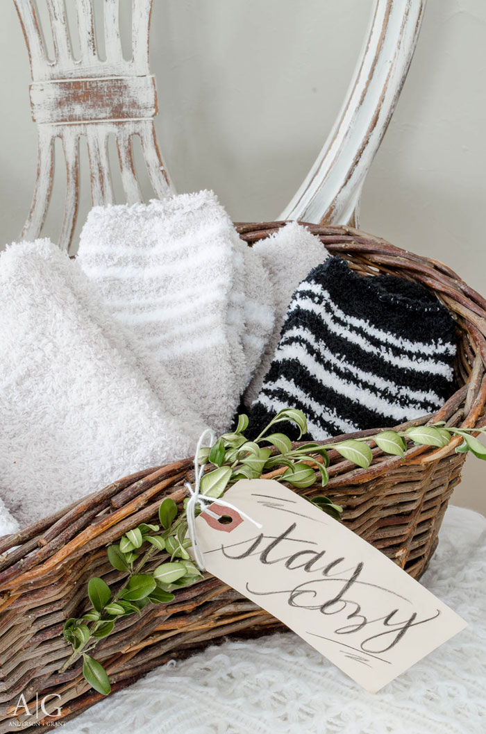 During the cold winter months, fill a basket with heavy socks to keep your guests feet warm while they visit.  ||  www.andersonandgrant.com