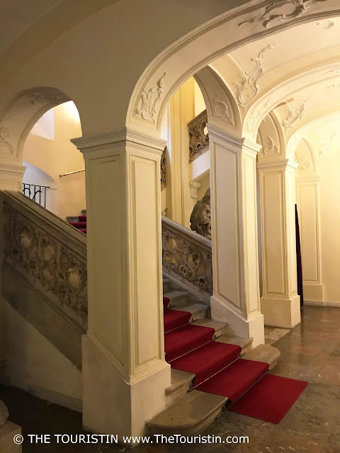 Vaulted staircase with red carpet at the Mirbach Palace in Bratislava in Slovakia