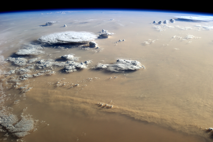 Dust and Clouds Dance Over the Sahara September 21, 2014 by NASA
