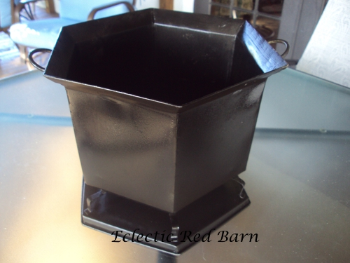 Metal basket after spray painted black