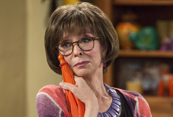 image of Rita Moreno as Lydia on One Day at a Time, clutching an orange umbrella to her cheek