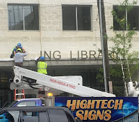 Silver Spring Library sign being put up